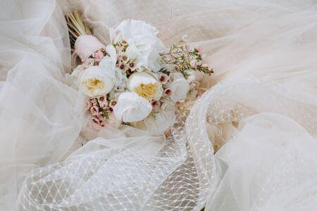 wedding decor flowers postcard on a veil dress white beige