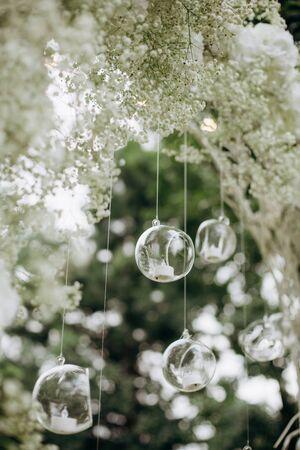 wedding decor flowers postcard ball glass hang shine reflection transparent Фото со стока