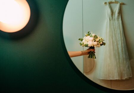 wedding bride dress bouquet in mirror reflection decor holiday objects event