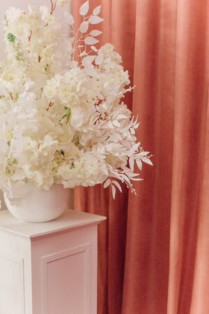 white stand flowers branches decor holiday objects event Фото со стока