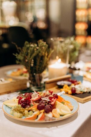 snacks fruits on the table in a plate holiday decor delicious food