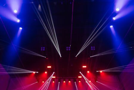 concert hall musical performance stage with light people hands crowd 版權商用圖片