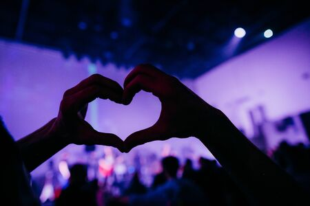 hands heart shape concert hall musical performance stage with light 版權商用圖片