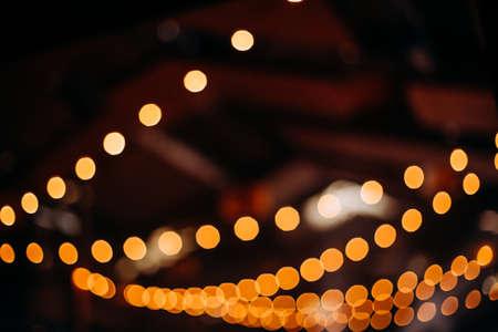 retro street garlands with yellow light and beautiful blur 版權商用圖片