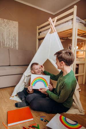 family mom son drawing rainbow room kids wigwam