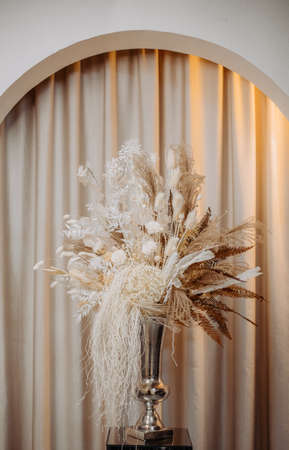 decorated with dry luxe flowers interior columns and arch curtains