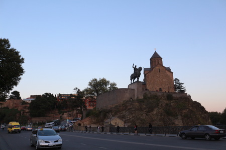 hill of the king: The View Of Metekhi Church And Equestrian Statue Of King Vakhtang Gorgasali In Tbilisi