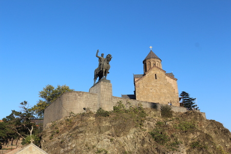 turistic: The Statue Of King Vakhtang Gorgasali And Metekhi Church In Tbilisi Editorial