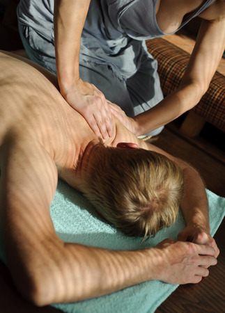 A woman makes a massage on man
