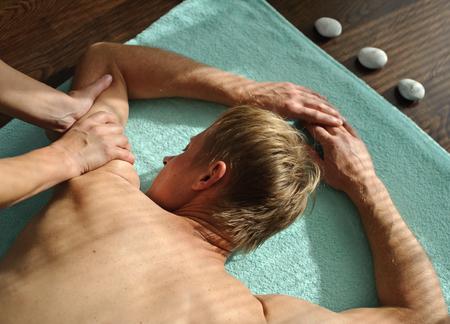 A woman makes a massage on a man