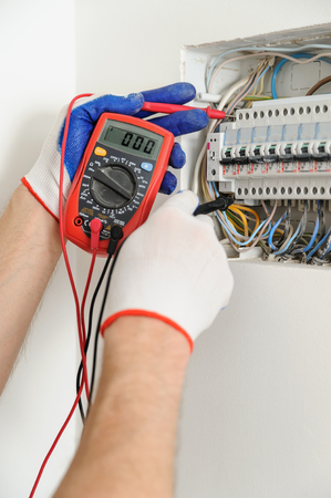 electrician check voltage in electrical fuse box with a multimeter electrician replace fuse box electrician fuse box #2