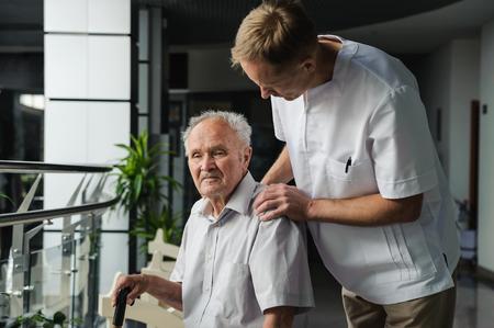 healthcare worker: Healthcare worker interested in health elderly man Stock Photo