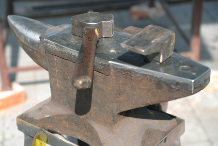 Blacksmith working tool - a sledgehammer and anvil