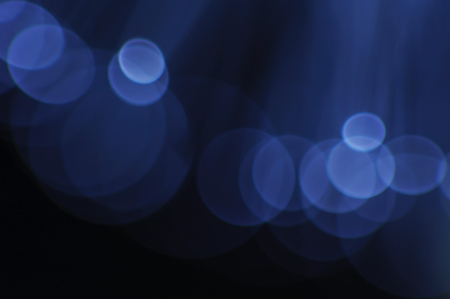 Abstract blue flashing lights on a dark background