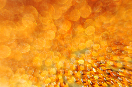Gold and orange lights bokeh. Festive background.