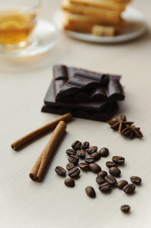 Coffee beans with cinnamon sticks, star anise and chocolate