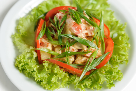 vegetable salad with tomatoes, lettuce, green onions and mushrooms of original decorated Stock Photo