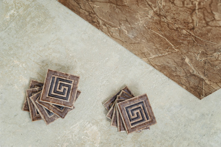 Ceramic tile on the floor and a small decorative tiles Фото со стока