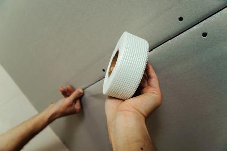 Worker paste net for seams between drywall boards