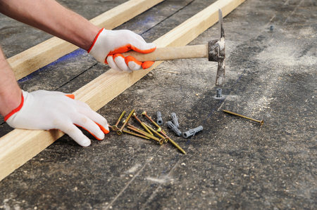 Worker put a plastic dubel in the concrete floor.