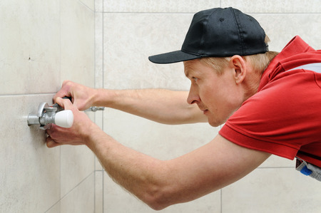 Plumber valve sets for towel warmer. It uses an adjustable wrench. Фото со стока