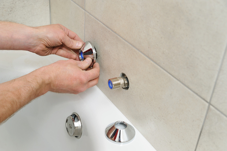 Plumber sets escutcheon of the bath faucet.