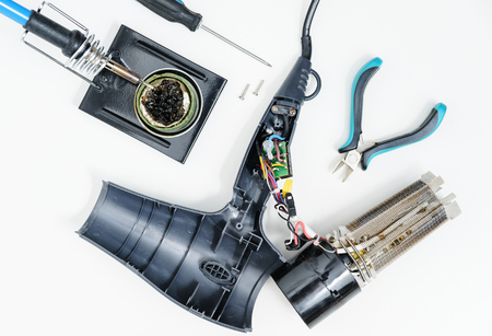 Hairdryer in a disassembled condition on a white background.