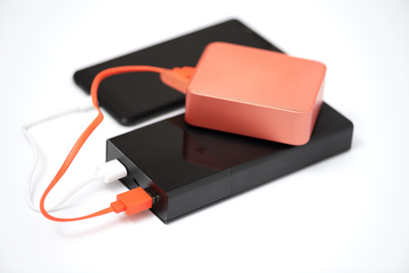 Power bank are connected the speaker and smartphone.