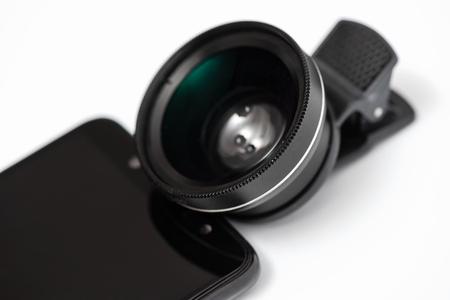Macro lens before attaching to a smartphone. Фото со стока
