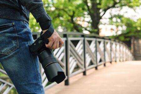 Photographe avec appareil photo.