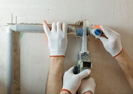 Installation of water pipes in the wall for the built-in shower. Soldering of parts of plumbing.