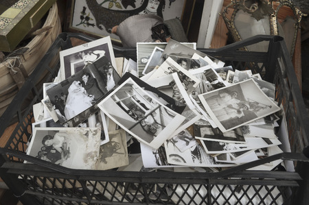 Derelict old photographs being sold at an antique shop in Istanbul, indifferent memories.