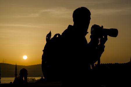 and he shines: Photographers take pictures at sunrise silhouette image the first light in the morning.
