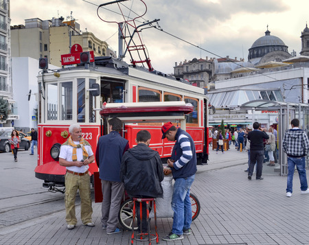 municipal utilities: Istanbul, Turkey - September 21, 2012: the former tram on Istiklal Street in Istanbul, Taksim-Tunel carry passengers. Greek Church in Taksim at the top looks.