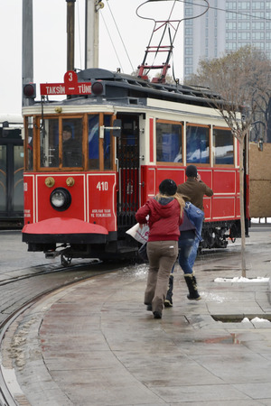 Istanbul, Turkey - September 21, 2012: the former tram on Istiklal Street in Istanbul, Taksim-Tunel carry passengers. A cold winter day. Editorial