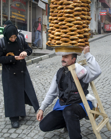 sesame street: Istanbul, Turkey -January 3, 2015: A vendor sells simit, a type of Turkish bread, in the streets of Istanbul. Editorial