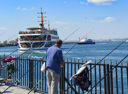 Istanbul, Turkey - September 9, 2012:  Ferries in Istanbul. Boats have traversed the waters of the Bosphorus for millennia and until the opening of the first Bosphorus bridge in 1973, were the only mode of transport between the European and Asian halves o