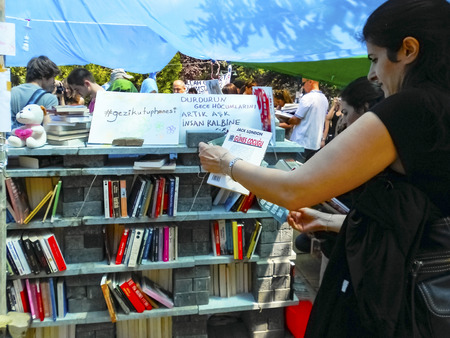 distributed: Istanbul, Turkey - June 5, 2013: All around the country starting in Taksim Travel Park on the eighth day of action began to build a library in the park. The library was filled with books was built in a day. The books were distributed free to the public. Editorial