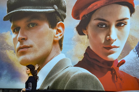 butterflys: Istanbul, Turkey - October 20, 2013: Turkish film The Butterflys Dream movie posters and street people showing interest. The Butterflys Dream, poetic life subjects, written and directed by Yilmaz Erdogan made the 2013 drama. Editorial