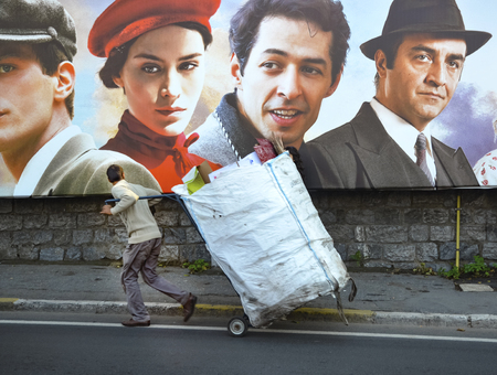 screenwriter: Istanbul, Turkey - October 20, 2013: Turkish film The Butterflys Dream movie posters and street people showing interest. The Butterflys Dream, poetic life subjects, written and directed by Yilmaz Erdogan made the 2013 drama. Editorial