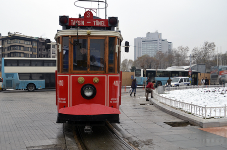 municipal utilities: Istanbul, Turkey - September 21, 2012: the former tram on Istiklal Street in Istanbul, Taksim-Tunel carry passengers. A cold winter day.Taksim Square, children playing snowballs Editorial