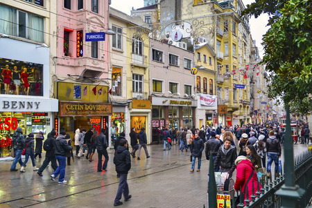 beyoglu: Istanbul, Turkey - December 21, 2012: Istiklal Avenue in the Beyoglu district of Istanbul. Istiklal Street is the most popular streets of Istanbul. Istiklal street, cafes, bars, restaurants, shopping centers and historical texture with a 24-hour entertain