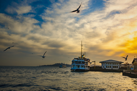 the marmara: Istanbul, Turkey - February 2, 2014: Sea of Marmara, the Bosphorus in the evening. sunset, seagulls and people .Istanbul, Besiktas pier appears.