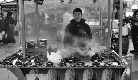 indispensable: Istanbul, Turkey - December 12, 2012: Indispensable to Istanbul roasted chestnuts. Every season there in the streets. Editorial