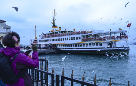 Istanbul, Turkey - December 22, 2012: Ferries in ?stanbul.boats has traversed the waters of the Bosphorus for millennia and until the opening of the first Bosphorus bridge in 1973 were the only mode of transport between the European and Asian halves of Is Editorial
