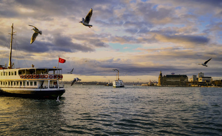 millennia: Istanbul, Turkey - January 19, 2013: Ferries in ?stanbul.boats has traversed the waters of the Bosphorus for millennia and until the opening of the first Bosphorus bridge in 1973 were the only mode of transport between the European and Asian halves of Ist Editorial