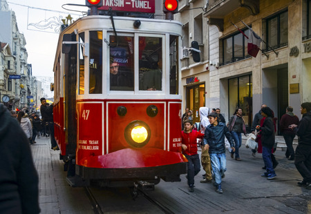 municipal utilities: Istanbul, Turkey - December 29, 2013: Istiklal Street and Independence Avenue (Turkish: Independence Avenue) is visited by nearly 3 million people in a single day during the weekend in Istanbul, Turkey, it is one of the most famous streets.