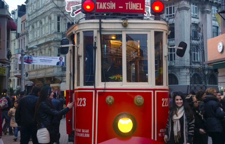 tunel: Istanbul, Turkey - December 29, 2013: A historic tram in front of the Beyoglu station of Tunel (1875) at the southern end of Istiklal Avenue.