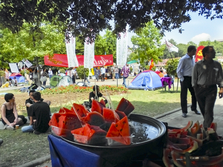 Istanbul, Turkey - June 5, 2013: Taksim Gezi Park in the food, a watermelon seller.  A wave of demonstrations and civil unrest in Turkey began on 28 May 2013, initially to contest the urban development plan for Istanbuls Taksim Gezi Park. The protests we Editöryel