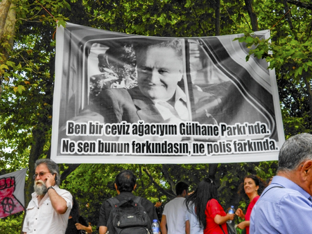 guy fawkes mask: Istanbul, Turkey - June 5, 2013: Nazim Hikmet Ran, Turkish poet, playwright, novelist. Romantic communist and romantic revolutionary is defined as a poster hung in the protest area. A wave of demonstrations and civil unrest in Turkey began on 28 May 2